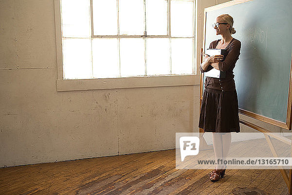 Teacher looking out of window