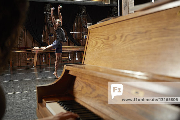 Ballet dancer in position  piano in foreground