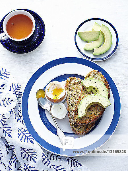 Boiled egg with toast and avocado