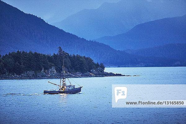 Fishing boat at dusk  Juneau  Alaska  USA