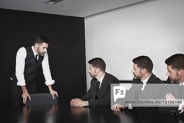 Businessmen in meeting  multiple image