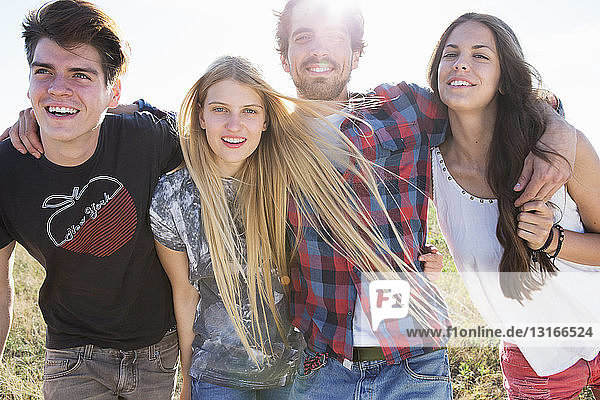 Four friends smiling toward camera