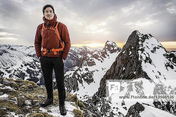 Hiker with hands in pockets  Kellenspitze  Tannheim mountains  Tyrol  Austria