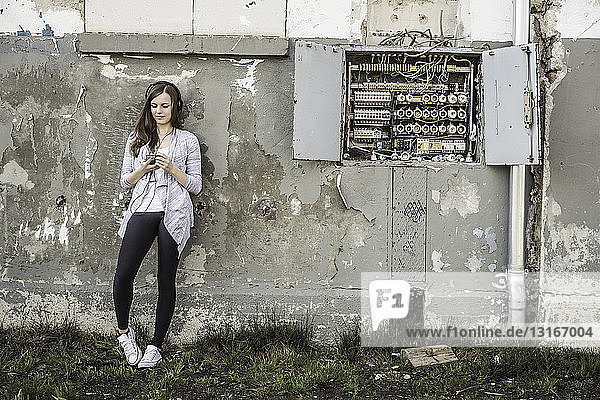 Teenage girl hanging out at abandoned building