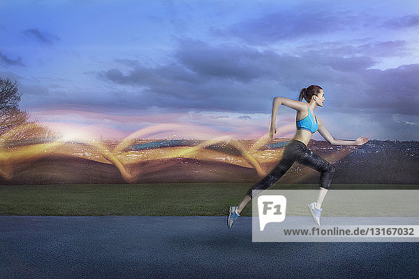 Young woman running with light trails