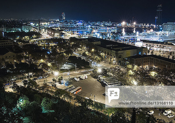View of city and harbor at night  Barcelona  Spain