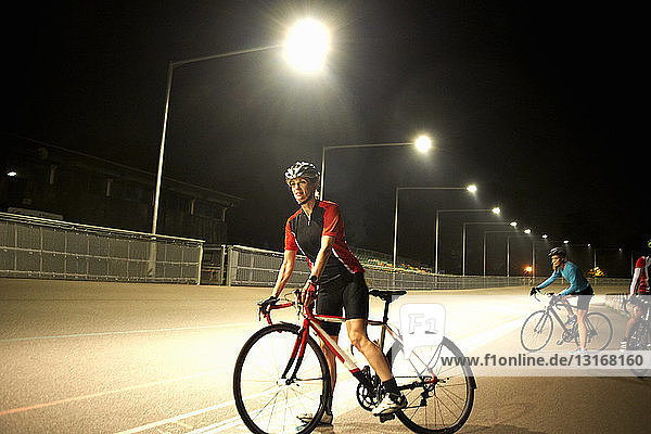 Cyclists on track at velodrome  outdoors