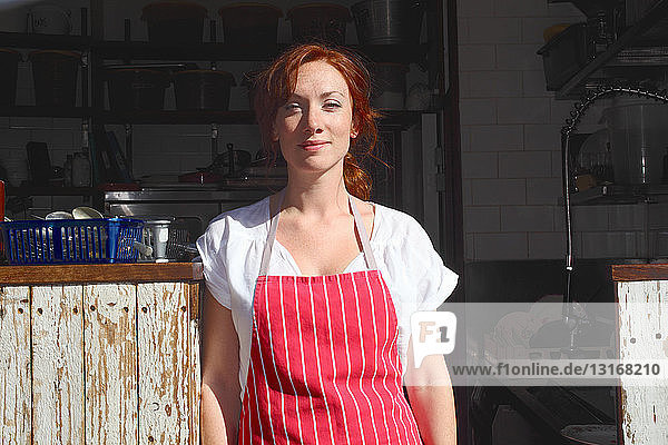 Woman in apron working outdoors
