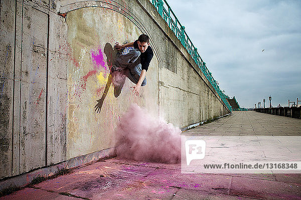 Parkour athlete experimenting with movement and powder paint at Balcombe Viaducts  Sussex  United Kingdom