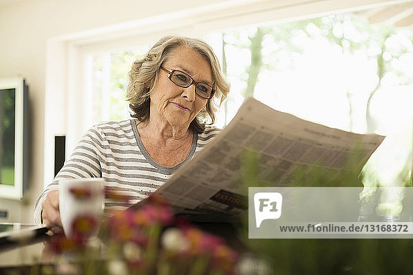 Senior woman reading the newspaper