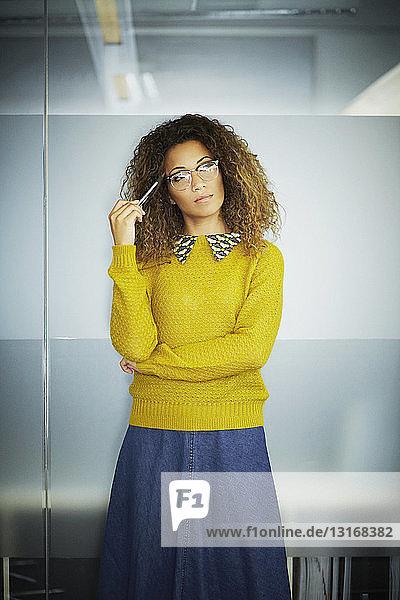 Female office worker holding pen