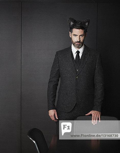 Businessman wearing fancy dress ears