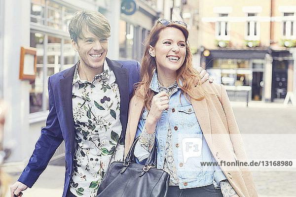 Stylish couple strolling on street  London  UK