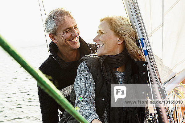 Mature couple on sailing boat  smiling