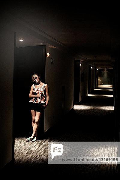 Girl in a hotel corridor