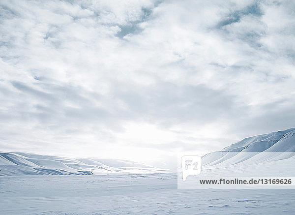 Mountains and snow-covered field