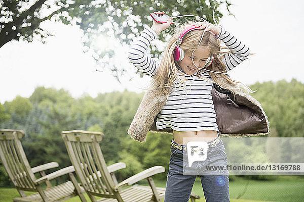 Girl dancing to music on headphones