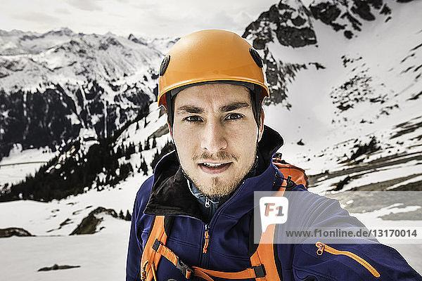 Portrait of young man wearing climbing helmet