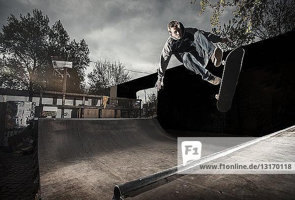 Skateboarding on mini ramp  360 flip to fakie  Berlin  Germany