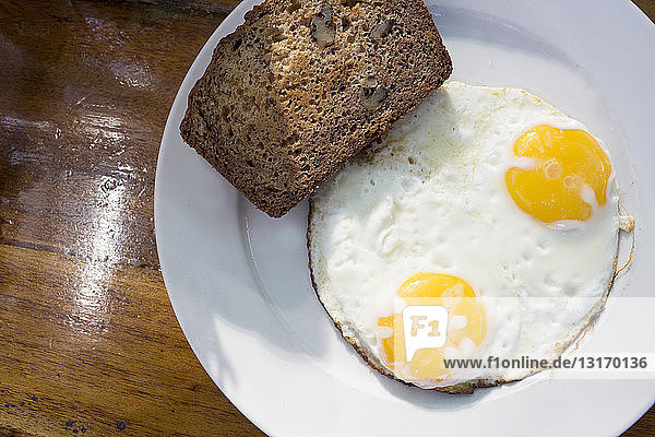 Sunny side up eggs with banana bread