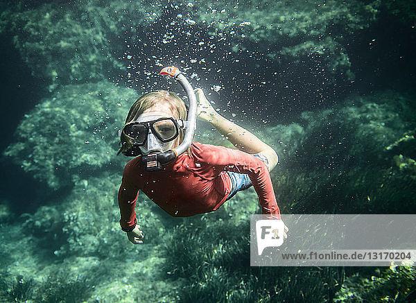 Underwater portrait of boy snorkeling  Menorca  Balearic islands  Spain