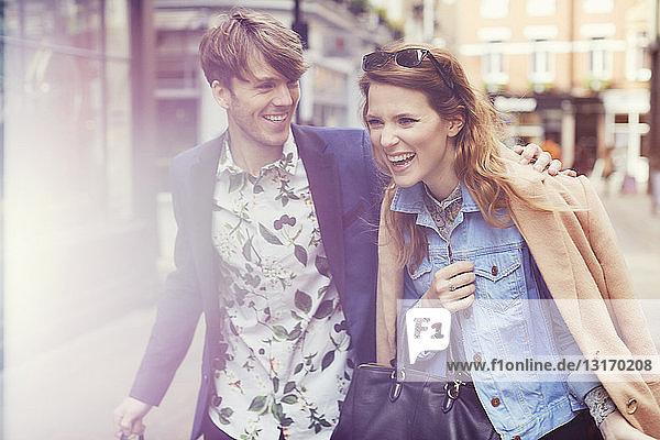 Stylish couple laughing on street  London  UK