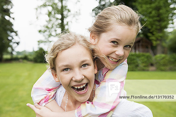 Two sisters hugging  portrait