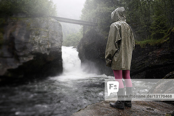 Person by a waterfall