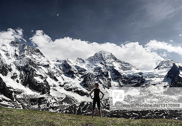 Woman overlooking glacial landscape