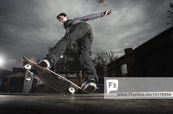 Skateboarding on mini ramp  5-0 grind to fakie  Berlin  Germany
