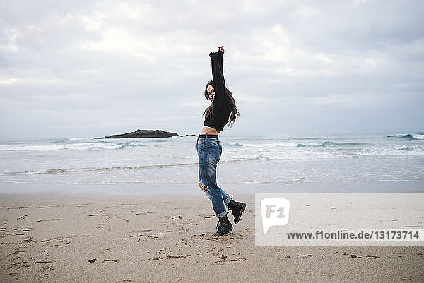 Spain  happy young woman on the beach
