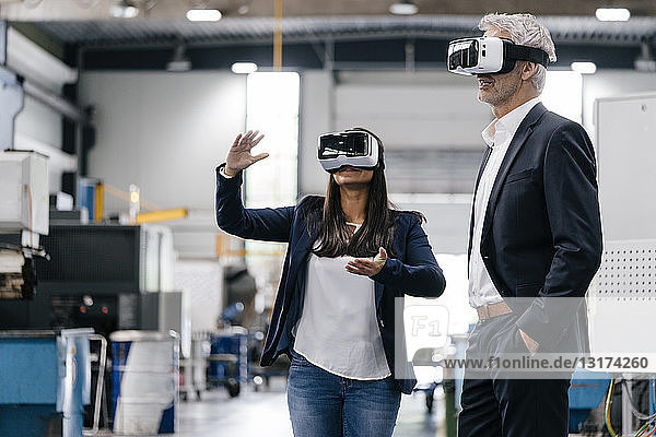 Businessman an woman in high tech enterprise  using VR glasses