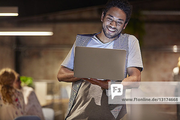 Young man working in creative start-up company  using laptop