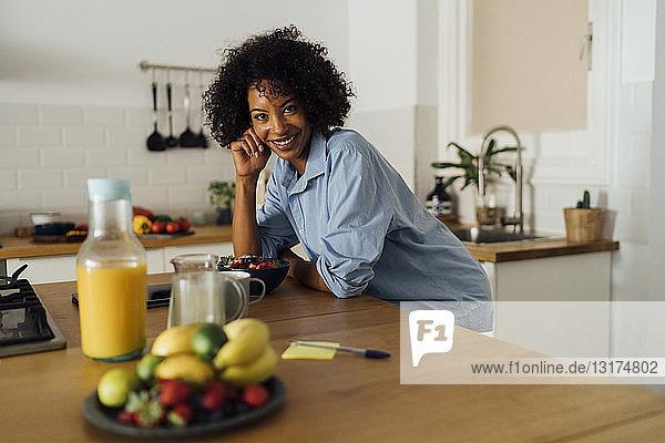 Woman having a healthy breakfast in her kitchen