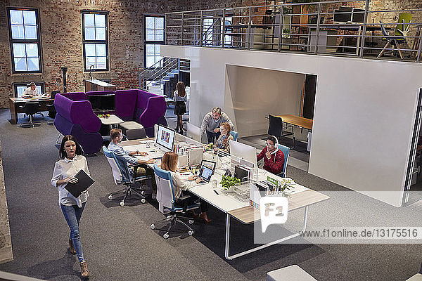 People working in big modern office