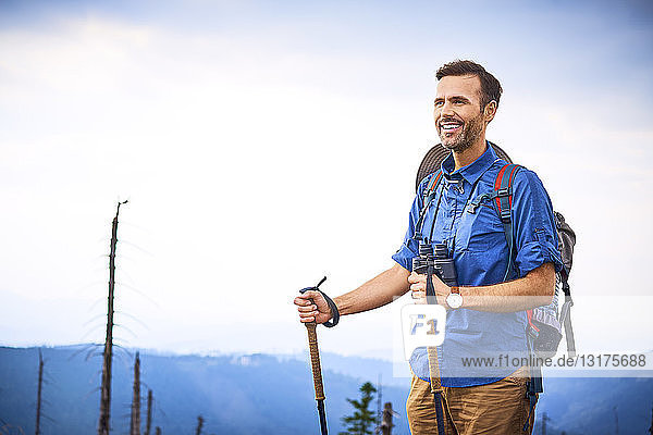 Portrait of smiling man during hiking trip