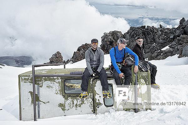Russia  Upper Baksan Valley  Caucasus  Mountaineers ascending Mount Elbrus  taking a break