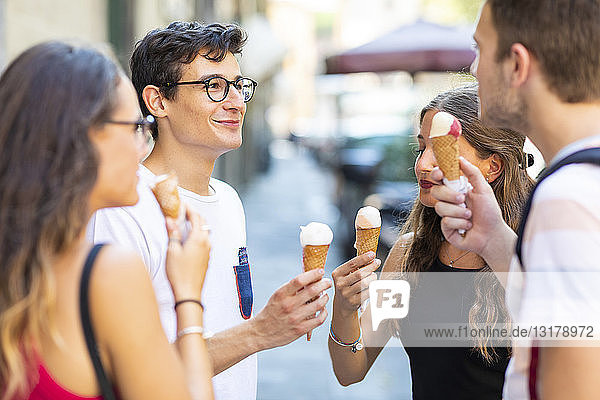 Group of friends meeting in the city and eating ice cream