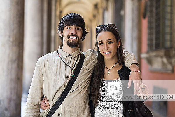 Italy  Bologfna  portrait of happy young couple arm in arm