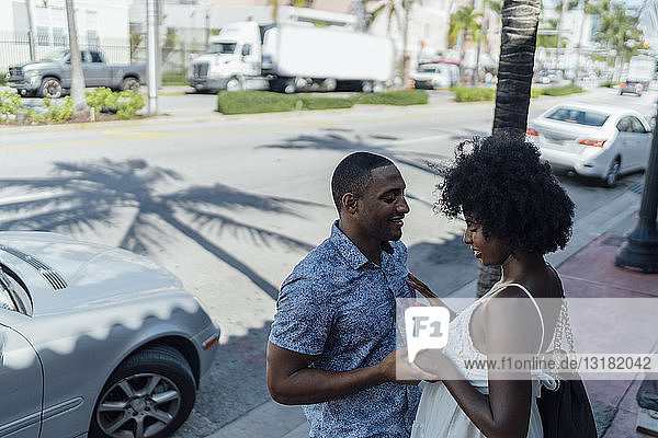 USA  Florida  Miami Beach  smiling affectionate young couple in the city