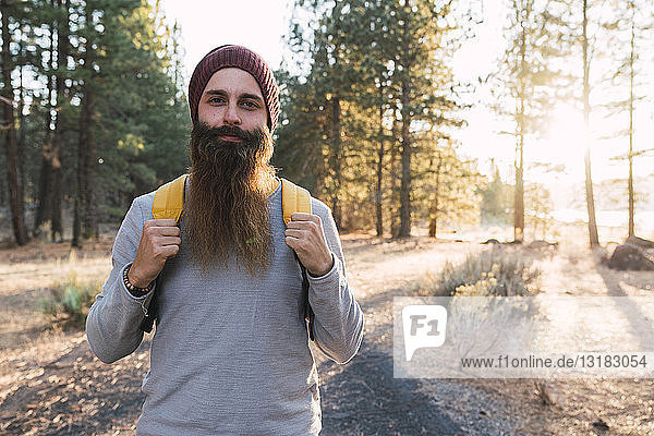 USA  North California  portrait of bearded man in a forest near Lassen Volcanic National Park