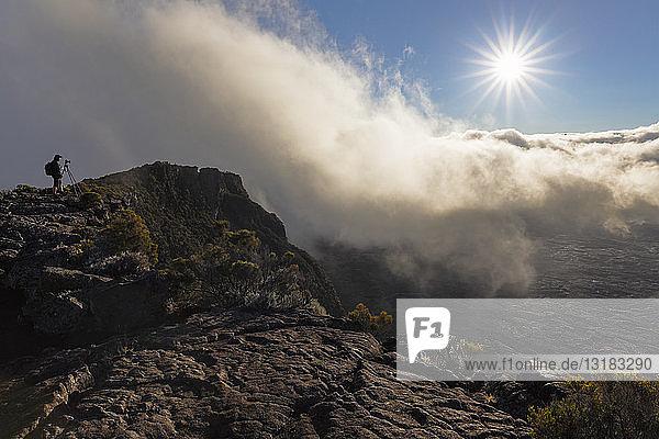 Reunion  Reunion National Park  Shield Volcano Piton de la Fournaise  Photographer at Pas de Bellecombe against the sun