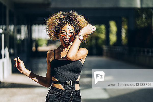 Portrait of young woman dancing outdoors