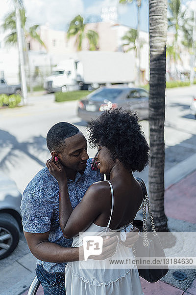 USA  Florida  Miami Beach  smiling affectionate young couple embracing in the city