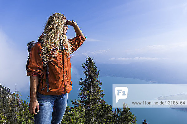 Young woman hiking in the Bavarian mountains  looking at Lake Walchensee
