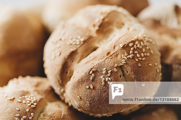 Close up fresh baked wheat roll with seeds
