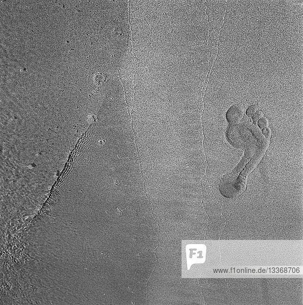 Fußabdrücke auf Sand