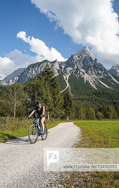 Cyclist with mountain bike  on the Via Claudia Augusta cycle path  crossing the Alps  Sonnenspitze at the back  mountain landscape  near Ehrwald  Tyrolean Alps  Tyrol  Austria  Europe