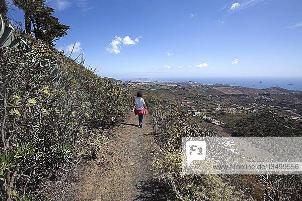 Female hiker on the crater path around the volcano Bandama  Caldera de Bandama  at Tafira  Gran Canaria  Canary Islands  Spain  Europe
