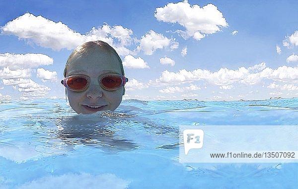 Mädchen mit Taucherbrille schwimmend im türkisblauen Meer